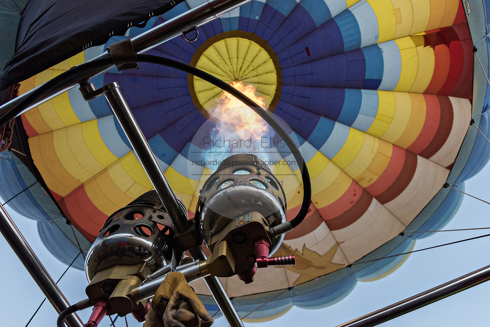Flames shoot hot air into a balloon as it begins ascending over the skies of San Miguel de Allende, Mexico.