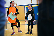 """Hannah Sobko and Alice Marchese of Penfield's Cobbles Elementary School speak with judges after their group's performance in the """"Furs, Fins, Feathers, and Friends"""" challenge at the Odyssey of the Mind Region 14 tournament at Spencerport High School on Saturday, March 12, 2016."""
