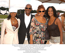Singer ERROLL BROWN with his wife and daughters, left LEONIE BROWN and right COLLETTE BROWN, at a polo match in Berkshire on 27th July 2003.PLU 35