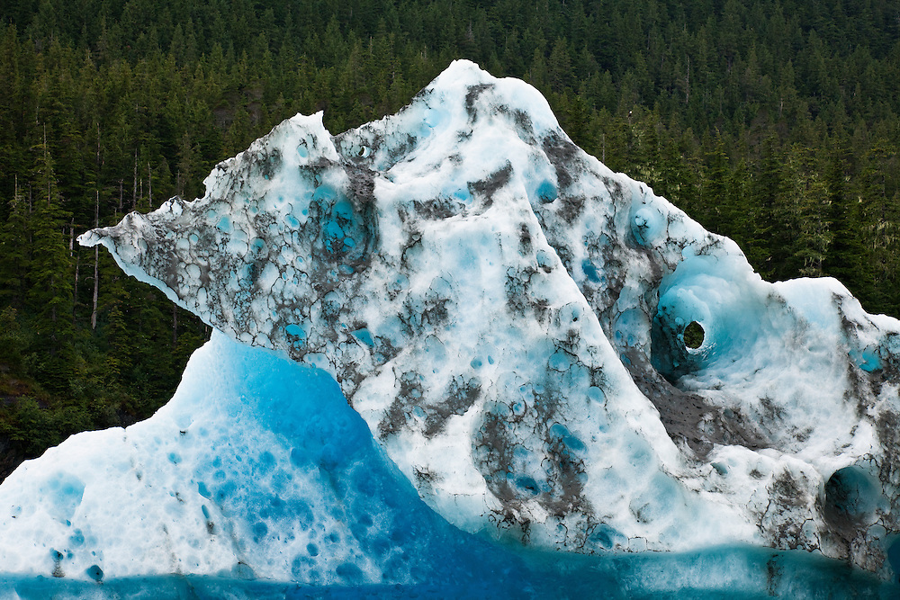 Dirt adds texture to an iceberg in Tracy Arm fjord in the Inside Passage of Southeast Alaska. Summer. Afternoon.