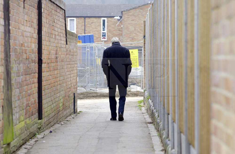 © Licensed to London News Pictures 04/05/2004.A man walks through a passage way in Craylands estate, an impoverished council estate in Basildon, Essex..Basildon, UK.Photo credit: Anna Branthwaite