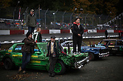 A driver (R) and her crew watch the start of a race during the time trials and qualifying at Agassiz Speedway in Agassiz, BC (2012)