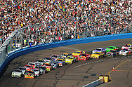 Apr 10, 2010; Avondale, AZ, USA; NASCAR Sprint Cup Series driver Tony Stewart (left) and teammate Ryan Newman lead the field on a double file restart during the Subway Fresh Fit 600 at Phoenix International Raceway. Mandatory Credit: Jennifer Stewart-US PRESSWIRE