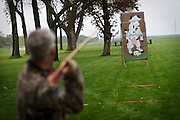 "An atlatl competitor takes aim at the iconic ""Raging Cow"" during Grinnell's annual Raging Cow atlatl tournament out past the softball fields. BEN BREWER/Grinnell College"