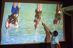 June 11, 2017 - Merrick, New York, United States - American Grit contestant CHRIS EDOM (wearing white T-shirt), 48, of Merrick, hosts backyard Viewing Party for Season 2 premiere. Edom walked up to large screen and pointed to contestants hanging upside down over water in first challenge, as his guests watched Episode 1 of FOX network reality television series broadcasst that Sunday night outdoors. (Credit Image: © Ann Parry via ZUMA Wire)
