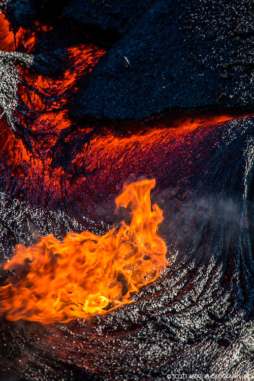 Flowing, burning lava field from Kilauea Volcano, Volcanoes National Park, Big Island, Hawaii