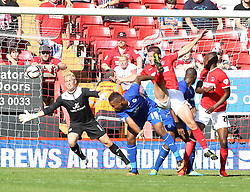 Leicester City's Kasper Schmeichel saves from Charlton Athletic's Yann Kermorgant  - Photo mandatory by-line: Robin White/JMP - Tel: Mobile: 07966 386802 31/08/2013 - SPORT - FOOTBALL - The Valley - Charlton - Charlton Athletic V Leicester City - Sky Bet Championship