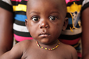 A boy sits on his mother's lap at the Slipway clinic in Monrovia, Montserrado county, Liberia on Monday April 2, 2012.