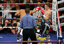 Manny Pacquiao connects with a right cross in round one during the Light Welterweight title fight at the MGM Grand, Las Vegas , Nevada, 2nd May 2009.