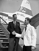 17/05/1959<br /> 05/17/1959<br /> 17 May 1959<br /> Joe Duggan, Wine Waiter, leaves for France. Gary Benson (Departure Bar, Dublin Airport) wishes Joe Duggan a good trip as he boards an Aer Lingus Viscount at Dublin Airport to begin a 3 week whirlwind tour of France. Joe who is bar attendant in the Red Bank won the trip as 1st prize in the French Wine contest.