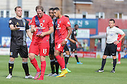 Mansfield Town midfielder Adam Chapman argues with York City defender Keith Lowe after Lowes boot comes off  during the Sky Bet League 2 match between York City and Mansfield Town at Bootham Crescent, York, England on 29 August 2015. Photo by Simon Davies.