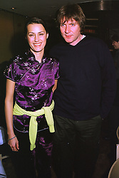 Singer SIMON LE BON and his wife model YASMIN LE BON,  at a party in London on 12th January 1999.MND 22