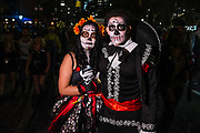 New York, NY - 31 October 2019. the annual Greenwich Village Halloween Parade along Manhattan's 6th Avenue. A calavera catrina and her escort.