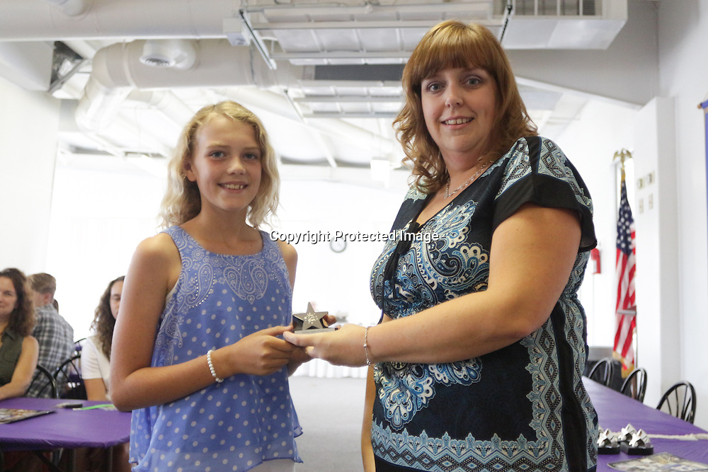 Makayla Obrensjki accepts an award from Star News Editor Sherry Jones for the 15 Under 15 project Sunday September 14, 2014 at Jungle Rapids in Wilmington, N.C. (Jason A. Frizzelle)