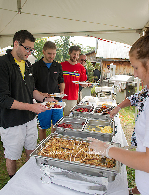 Ross Olchyk, Aaron Williams, Aaron Schifrin and Mark Schifrin make their way through the buffet line during Sunday brunch at Moulton Farm in Meredith.  Homemade waffles with fresh blueberries, peach french toast, flannel beet hash as well as traditional scrambled eggs, bacon and sausage, fruit salad with fresh peaches were among the buffet choices.   (Karen Bobotas/for the Laconia Daily Sun)