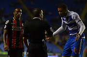 Reading's Michael Hectorand AFC Bournemouth's Callum Wilson get booked during the Sky Bet Championship match between Reading and Bournemouth at the Madejski Stadium, Reading, England on 14 April 2015. Photo by Mark Davies.