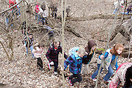 Outdoor facilitator John Betts of Vandalia watches as Girl Scouts climb a hill while on a mini-hike during Program Aide (PA) training at the Girl Scouts Urban Campus in Dayton, Saturday, March 3, 2012.