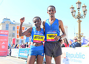 Race winners Joyciline Jepkosgei (KEN), left, and Tamirat Tola (ETH) pose at the Prague Half Marathon in Prague, Czech Republic on Saturday, April 17, 2017. Jepkosgei won the women's race in a world record 1:04:52. Tola won the men's race in 59:37. (Jiro Mochizuki/IOS)