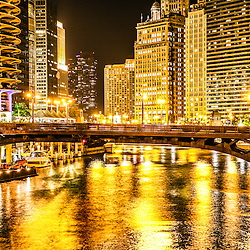 Picture of Chicago Dearborn Street Bridge at night. Photo includes the Chicago River, Marina City Towers, London Guarantee Building, and Hotel 71.