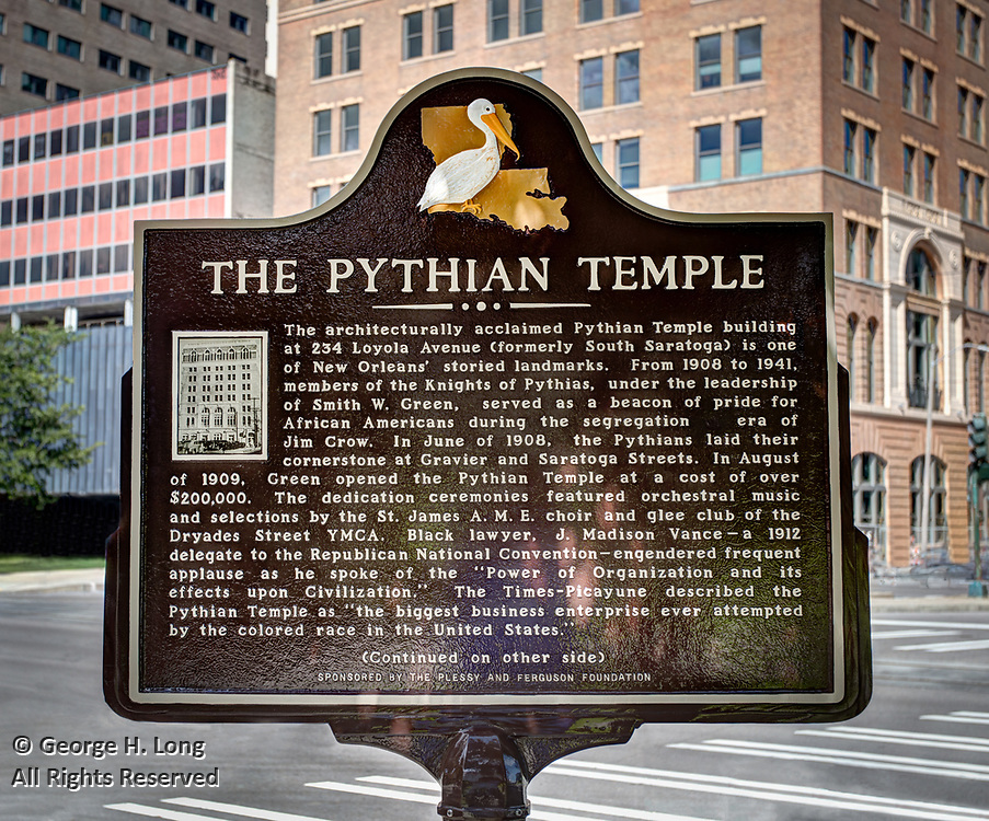 "Historical marker for The Pythian Temple, sponsored by the Plessy and Ferguson Foundation; The architecturally acclaimed Pythian Temple building at 234 Loyola Avenue (formerly South Saratoga) is one of New Orleans' storied landmarks.  From 1908 to 1941, members of the Knights of Pythias, under the leadership of Smith W. Green, served as a beacon of pride for African Americans during the segregation era of Jim Crow.  In June of 1908, the Pythians laid their cornerstone at Gravier and Saratoga Streets.  In August of 1909, Green opened the Pythian Temple at a cost of over $200,000.  The dedication ceremonies featured orchestral music and selections by the St. James A.M.E. choir and glee club of the Dryades Street YMCA.  Black lawyer, J. Madison Vance - a 1912 delegate to the Republican National Convention - engendered frequent applause as he spoke of the ""Power of Organization and its effects upon Civilization.""  The Times-Picayune described the Pythian Temple as ""the biggest business enterprise ever attempted by the colored race in the United States."""