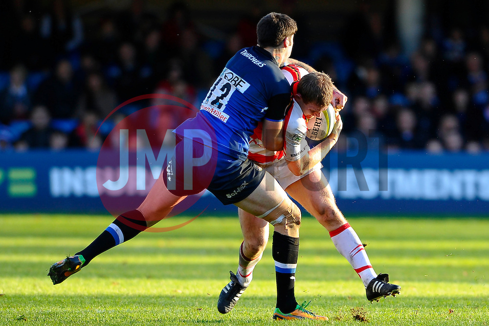 Bath Inside Centre (#12) Matt Banahan tackles Dragons Outside Centre (#13) Pat Leach during the first half of the match - Photo mandatory by-line: Rogan Thomson/JMP - Tel: Mobile: 07966 386802 09/11/2012 - SPORT - RUGBY - The Recreation Ground - Bath. Bath v Newport Gwent Dragons  - LV= Cup