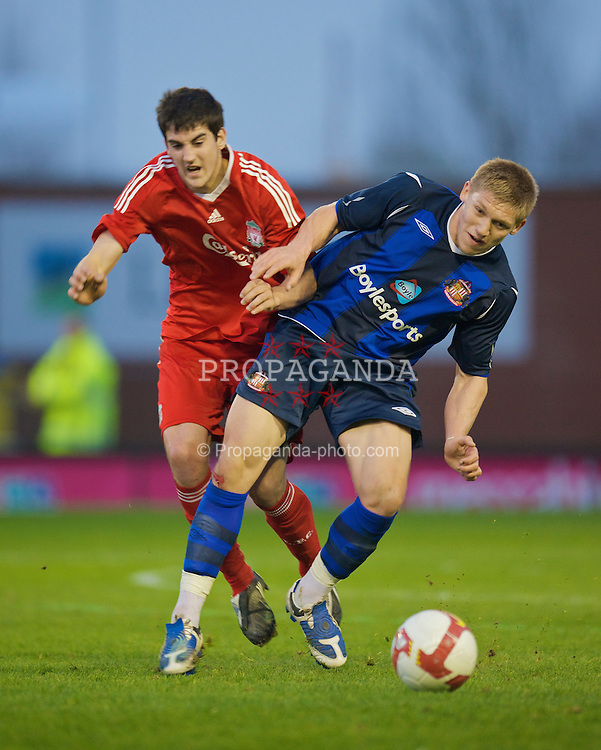 WARRINGTON, ENGLAND - Thursday, April 2, 2009: Liverpool's Mikel San Jose Dominguez in action against Sunderland's Jack Colback during the FA Premiership Reserves League (Northern Division) match at the Halliwell Jones Stadium. (Photo by: David Rawcliffe/Propaganda)