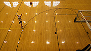 16203General art Ping center and rainy day: Johnny Hanson..Scott Trahey, a senior in physical education, shoots hoops in the Ping Center on a rainy Wednesday morning..Hanson Photo.