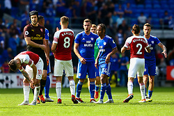 Aaron Ramsey of Arsenal shakes hands with Petr Cech of Arsenal after the final whistle of the match whilst Bobby Reid of Cardiff City heads for the tunnel - Mandatory by-line: Ryan Hiscott/JMP - 02/09/2018 -  FOOTBALL - Cardiff City Stadium - Cardiff, Wales -  Cardiff City v Arsenal - Premier League