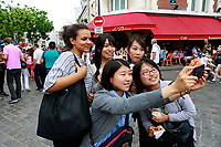 Montmartre, Paris -young women friends making selfies