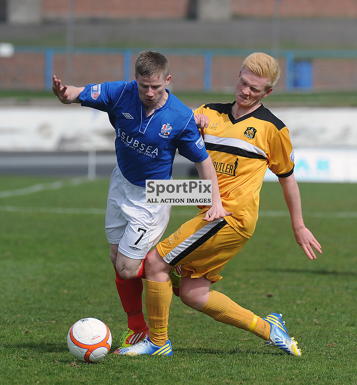 Cowdenbeath v Dumbarton, SDIV1, Central Park, 27-04-2013..Marc McKenzie hit by Scott Smith..(c) David Wardle | StockPix.eu