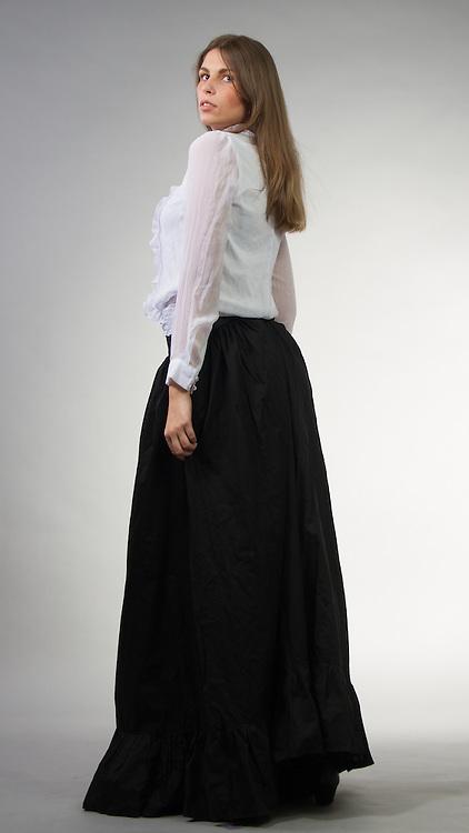 Female model posing in a historical dress.