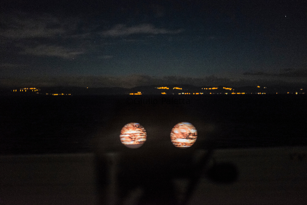 The team of the NGO Lighthouse Relief during a night patrol on the northern coasts of Lesbos, constantly checking the sea at night to see if any refugees boat is coming, the night shift is daily from midnight to 9 in the morning