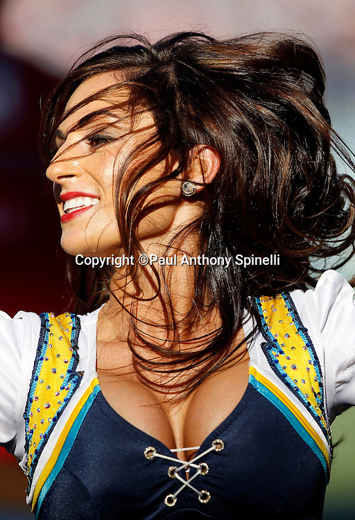 A San Diego Chargers cheerleader cheers during the NFL week 14 football game against the Kansas City Chiefs on Sunday, December 12, 2010 in San Diego, California. The Chargers won the game 31-0. (©Paul Anthony Spinelli)