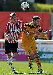 Newport County's Darren Jones challenges for the high ball with Exeter City's Graham Cummins - Photo mandatory by-line: Harry Trump/JMP - Mobile: 07966 386802 - 06/04/15 - SPORT - FOOTBALL - Sky Bet League Two - Exeter City v Newport County - St James Park, Exeter, England.