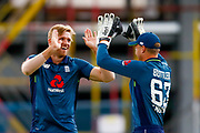 England ODI all rounder David Willey and England ODI wicket keeper Jos Butler celebrate the wicket of India ODI batsman Shikhar Dhawan from the bowling off England ODI all rounder David Willey  during the 3rd Royal London ODI match between England and India at Headingley Stadium, Headingley, United Kingdom on 17 July 2018. Picture by Simon Davies.
