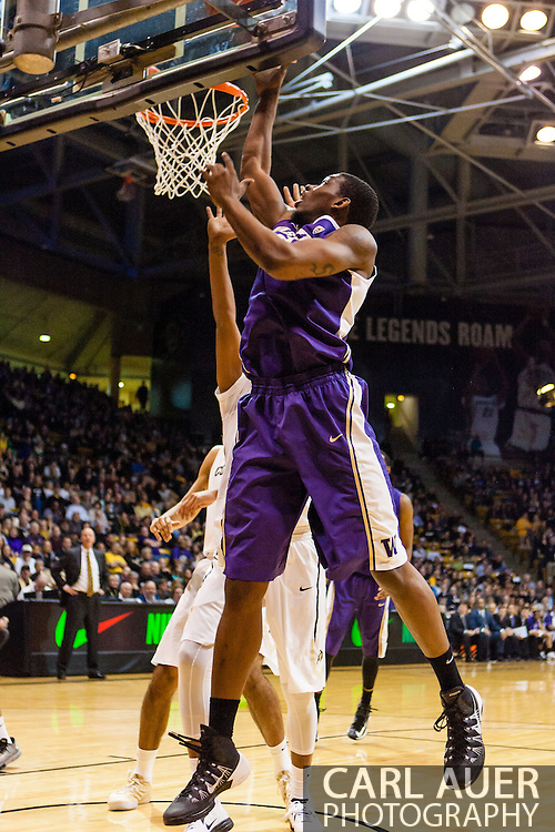 February 9th, 2014:  Washington Huskies junior forward Shawn Kemp, Jr. (40) attempts a lay up in the first half of the NCAA Basketball game between the Washington Huskies and the University of Colorado Buffaloes at the Coors Events Center in Boulder, Colorado