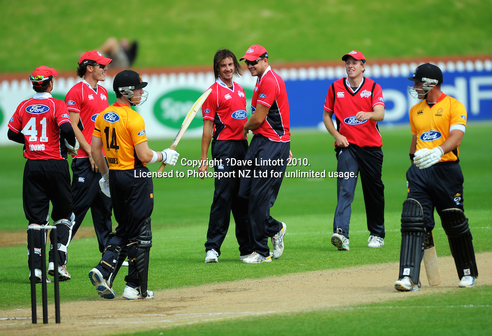 Canterbury bowler Richard Sherlock (centre) celebrates dismissing Luke Woodcock (right). One Day cricket - Wellington Firebirds v Canterbury Wizards at Allied Nationwide Finance Basin Reserve, Wellington on Thursday, 27 January 2011. Photo: Dave Lintott / photosport.co.nz