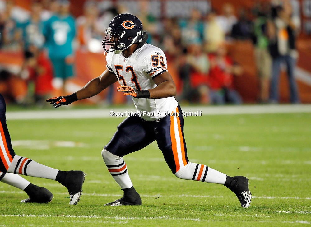 Chicago Bears linebacker Nick Roach (53) makes a move during the NFL week 11 football game against the Miami Dolphins on Thursday, November 18, 2010 in Miami Gardens, Florida. The Bears won the game 16-0. (©Paul Anthony Spinelli)