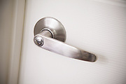 Stainless Steel Brushed Nickel Lever Door Handle on a White Door