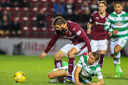 Celtic FC Defender Jozo Simunovic and Hearts FC Forward Juanma Dalgado battle  during the Scottish League Cup presented by Ulilita Energy quarter final match between Heart of Midlothian and Celtic at Tynecastle Stadium, Gorgie, Scotland on 28 October 2015. Photo by Craig McAllister.