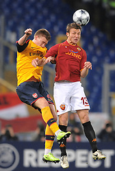 Nicklas Bendtner and Marco Motta challenge each other during the UEFA Champions League, Round of Last 16, Second Leg match between AS Roma and Arsenal at the Stadio Olimpico on March 11, 2009 in Rome, Italy.