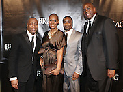 l to r: Gary Lambert, President of B.R.A.G, Latisha Daring, Colin Daring  and Magic Johnson at The B.R.A.G 39th Annual Scholarship and Awards Dinner Gala held at Cipriani Wall Sreet on October 23, 2009 in New York City...BRAG mission is to be the leading provider of resources and development suppoert that empowers African Americans to reach their highiest professional potential in retail and related industries