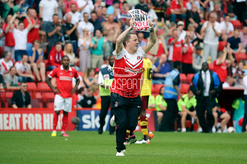 Charlton fan invades the pitch to protest during the Sky Bet Championship match between Charlton Athletic and Burnley at The Valley, London, England on 7 May 2016. Photo by Matthew Redman.