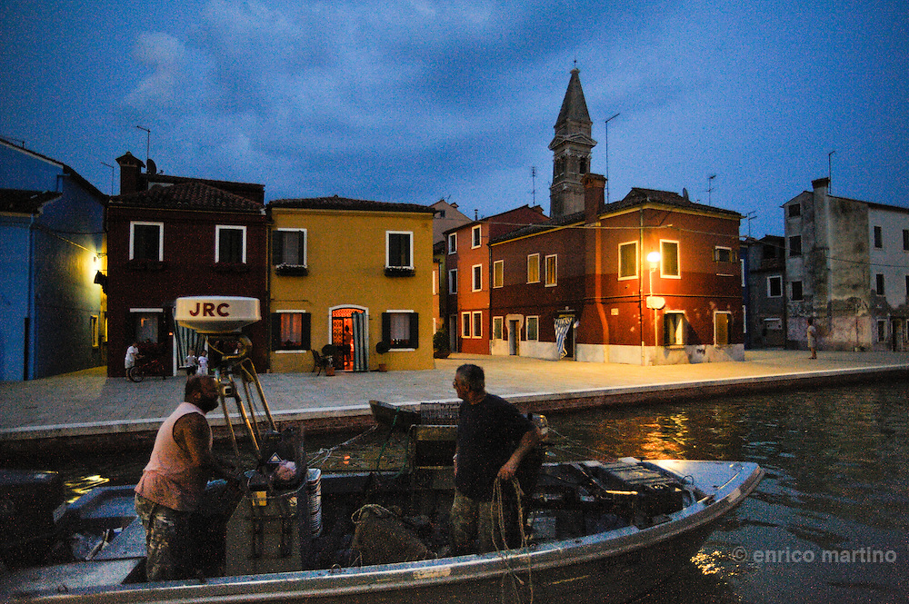 Burano island, at evening the tourists come back to Venice and the local people goes to the coffees houses, restaurants, or simply to walk around and meet.