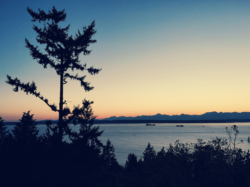 Sunset over the Olympic Mountains and Puget Sound from Golden Gardens in Seattle, Washington. Taken with an iPhone