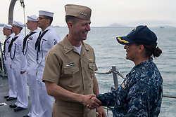 SOUTH CHINA SEA (May 15, 2017) Chief of Naval Operations Adm. John Richardson is welcomed aboard the Arleigh Burke-class guided-missile destroyer USS Sterett (DDG 104) by Sterett's commanding officer, Cmdr. Claudine Caluori, during Sterett's anchorage off the coast of Singapore. Sterett will join 26 other ships from 18 navies at the International Maritime Defense Exhibition 2017 (IMDEX-17) to promote dialogue, stability and security cooperation throughout the Indo-Asia-Pacific region. Sterett is part of the Sterett-Dewey Surface Action Group and is the third deploying group operating under the command and control construct called 3rd Fleet Forward. U.S. 3rd Fleet operating forward offers additional options to the Pacific Fleet commander by leveraging the capabilities of 3rd and 7th Fleets. (U.S. Navy photo by Mass Communication Specialist 1st Class Byron C. Linder/Released)170515-N-ZW825-344 <br /> Join the conversation:<br /> http://www.navy.mil/viewGallery.asp<br /> http://www.facebook.com/USNavy<br /> http://www.twitter.com/USNavy<br /> http://navylive.dodlive.mil<br /> http://pinterest.com<br /> https://plus.google.com
