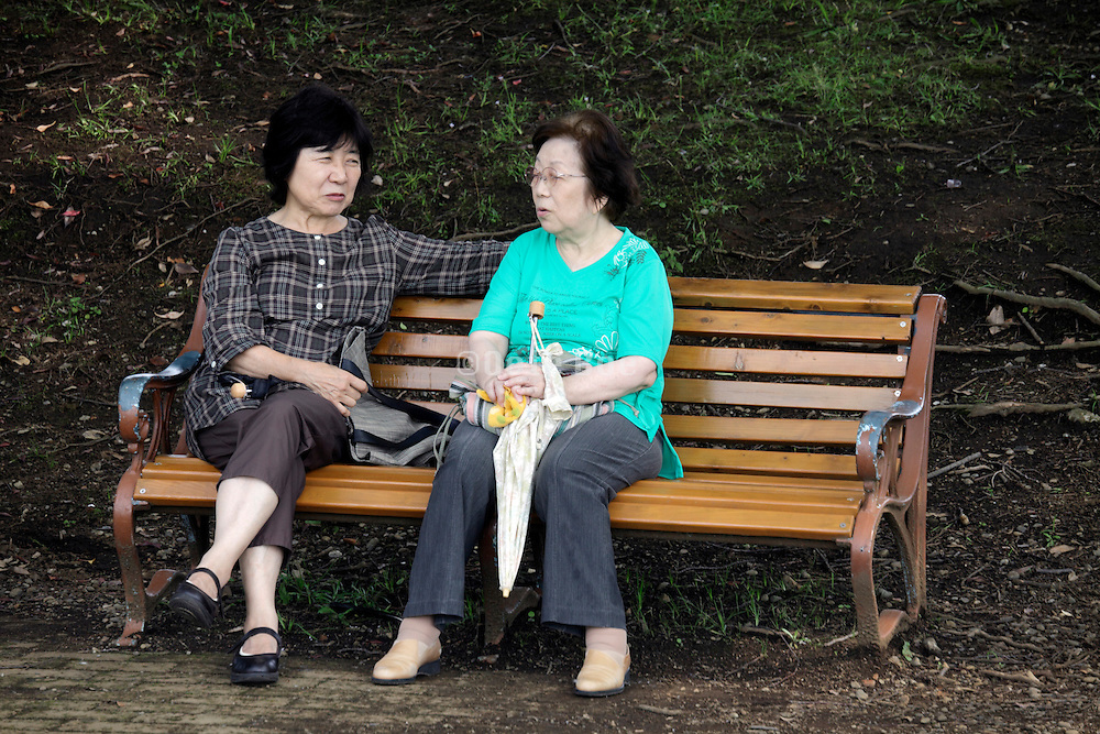 two woman on a park bench