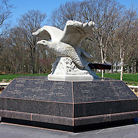 Monmouth County New Jersey Memorial commemorating the 147 county residents killed in the September 11 terrorist attack. The stone eagle sits on a base listing each victim's name, age and hometown. The eagle carries a beam from one of the fallen towers in its claws.