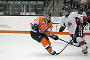 RIT's Kolbee McCrea watches a cleared puck during an exhibition game at RIT's Gene Polisseni Center on Monday, September 29, 2014.