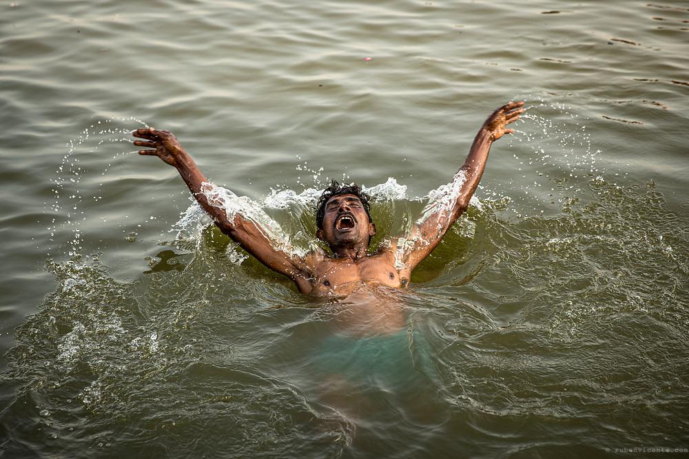 Man bathing in the Ganges. Varanasi, India